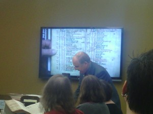 Tim Graham showing a manuscript on the WolfVision.